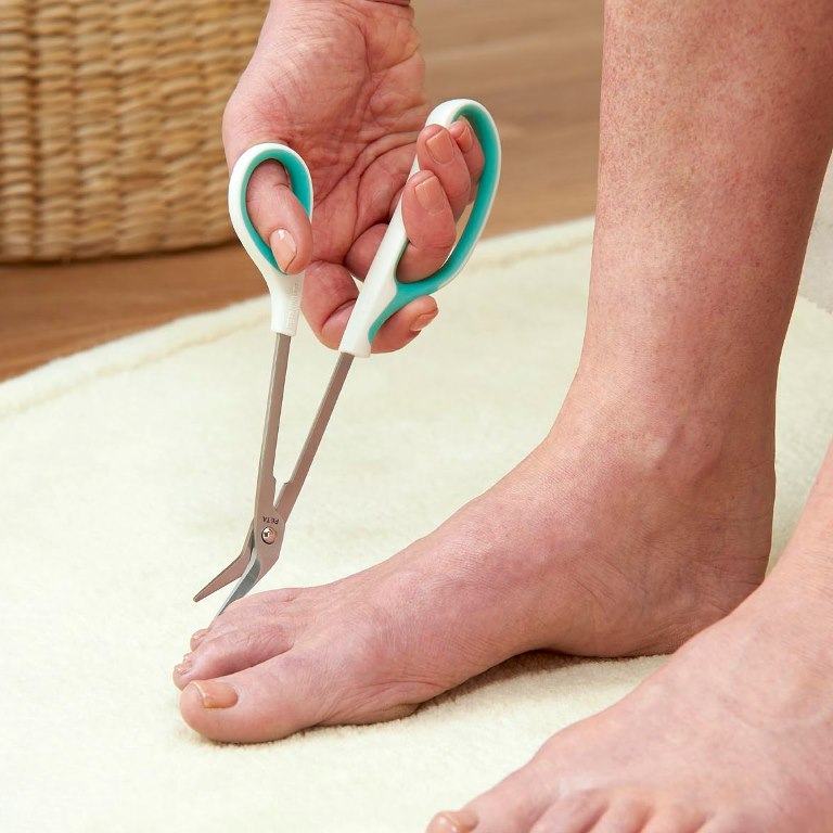 Easi Grip Long Reach Toenail Scissors Have A Loop Handle That Accommodates Several Fingers Allowing The User To Use Strength And Control Of Their Whole